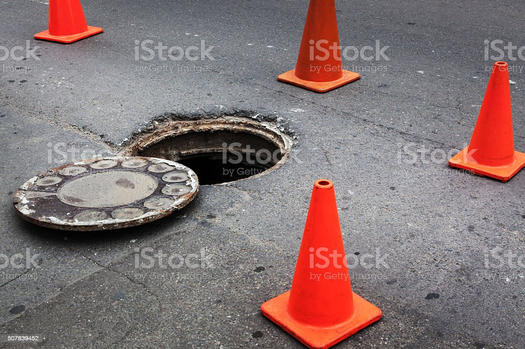 open manhole stock photo