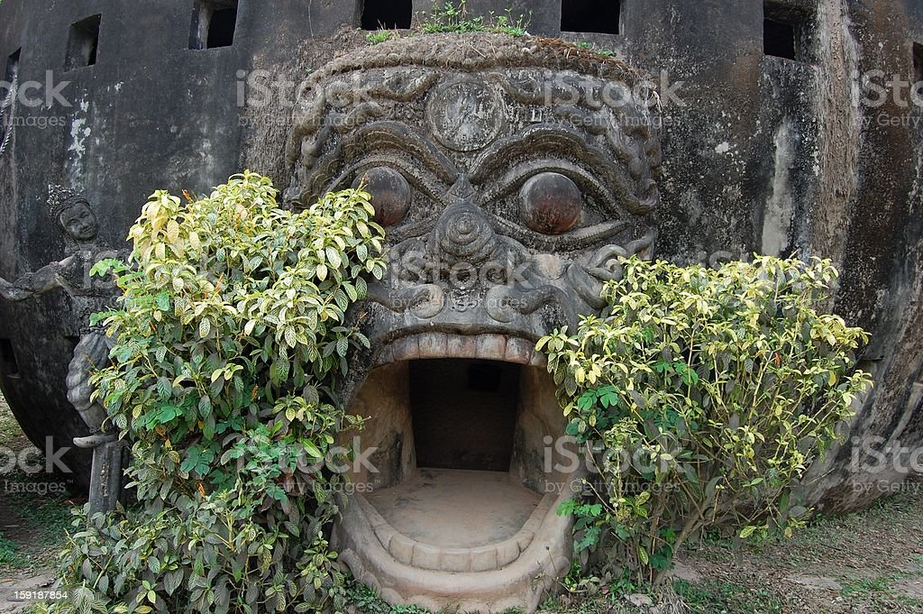 Open mouth gate at Buddha park, Vientiane Laos stock photo