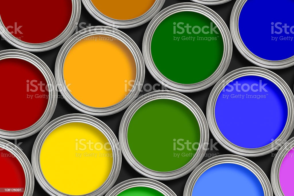 Open multi-colored paint tins from above royalty-free stock photo