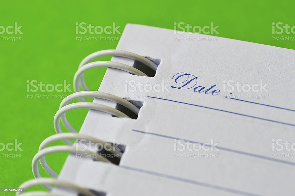 Open notebook and yellow pin out of focus isolated stock photo