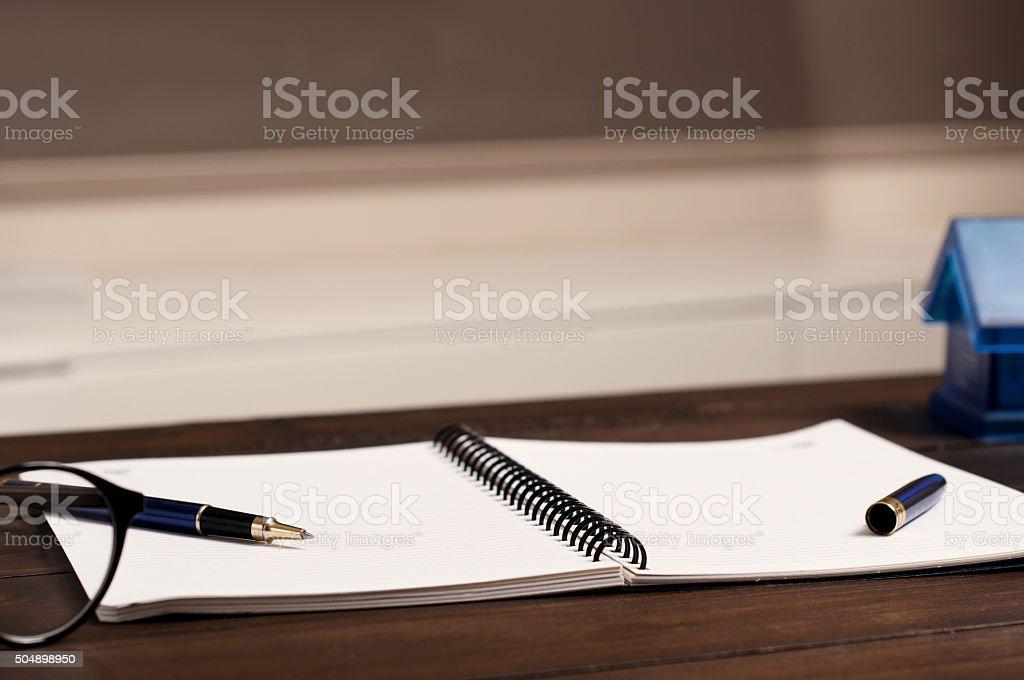 open notebook on office desk stock photo