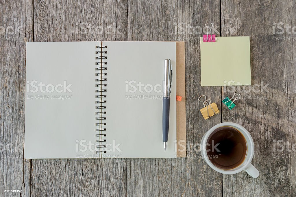 Open notebook on wooden background. stock photo