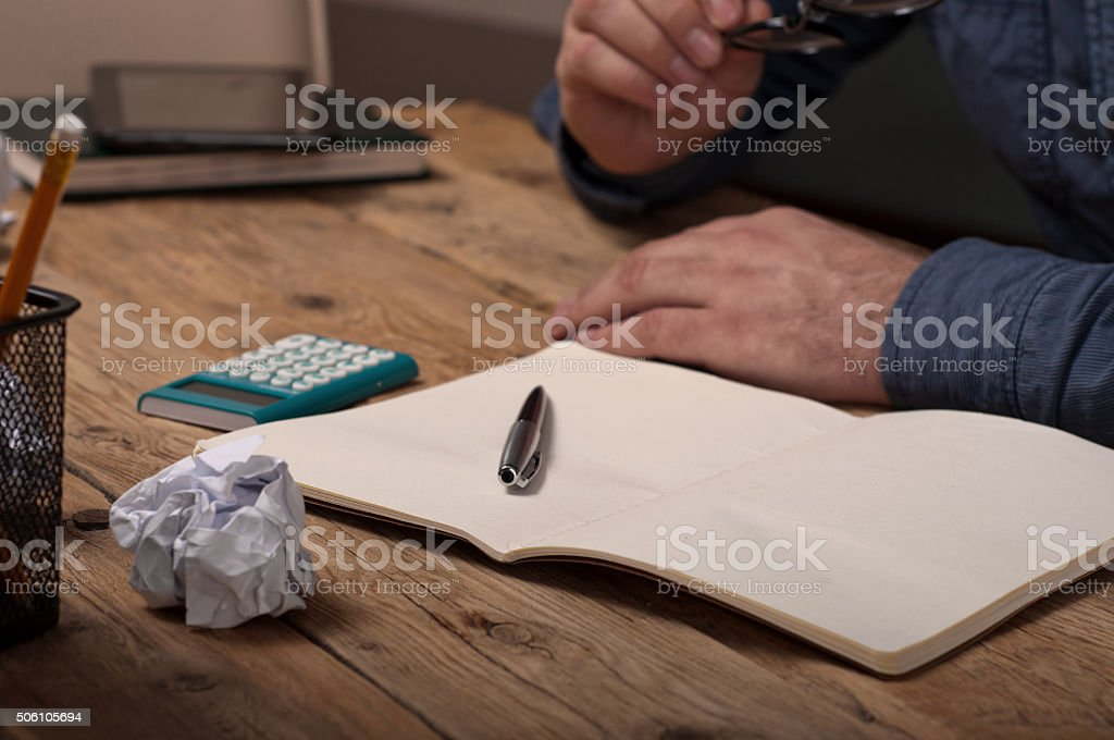 Open notebook with a pen on a wooden table stock photo