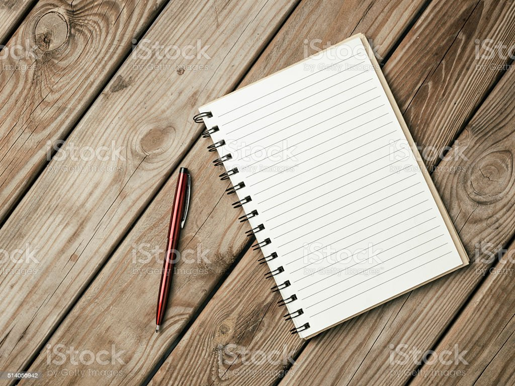 Open Notebook With Blank Page On Wooden Desk stock photo