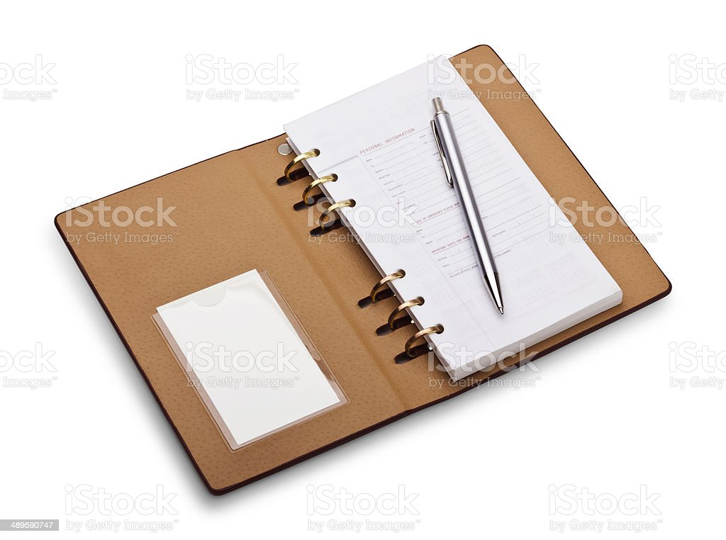 Open notebook with copper binding and stylish pen stock photo