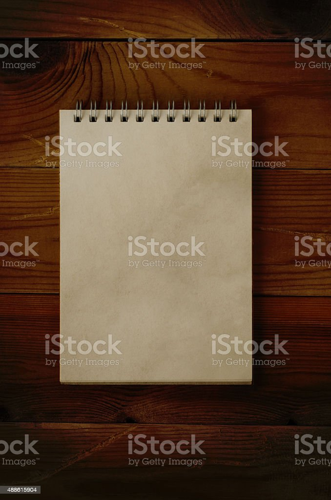 Open Notepad on Dark Wood stock photo