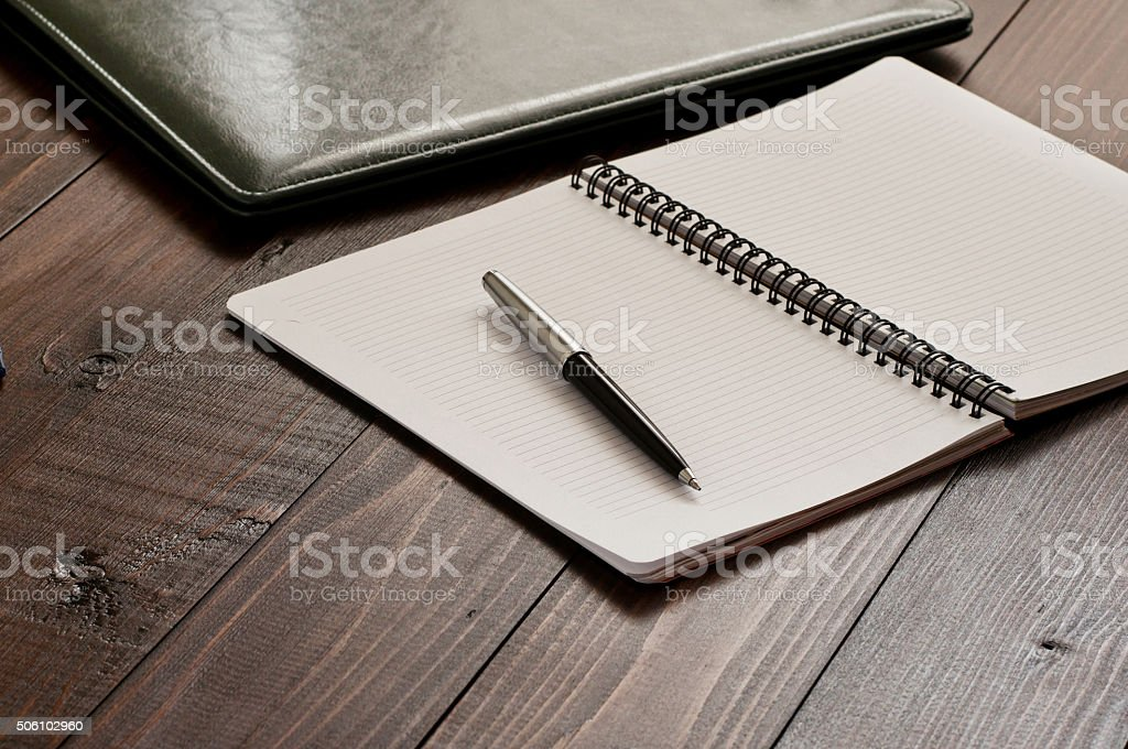 Open notepad with blank pages stock photo