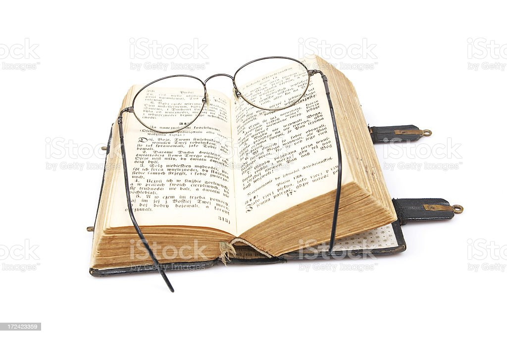 Open old book and glasses. royalty-free stock photo