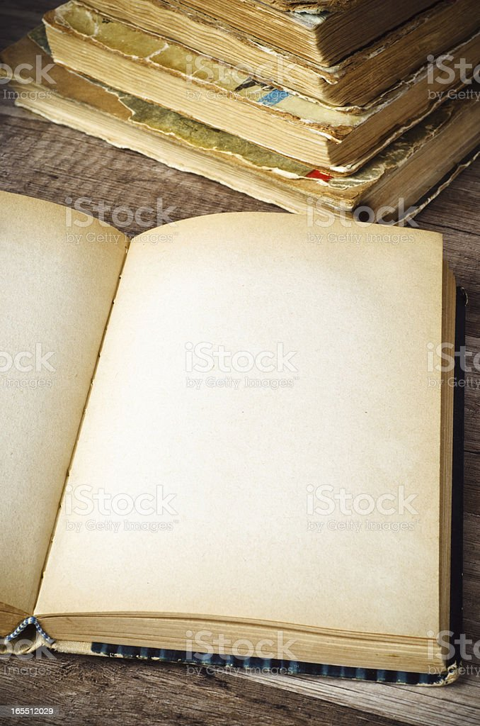 open old book on a wooden surface royalty-free stock photo