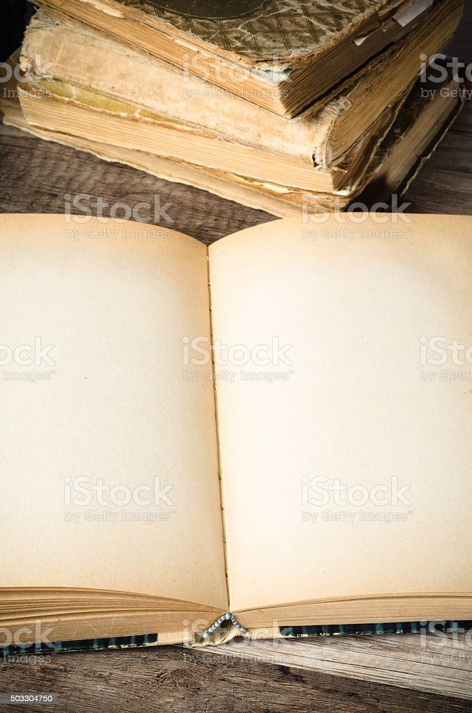 open old book on a wooden surface stock photo