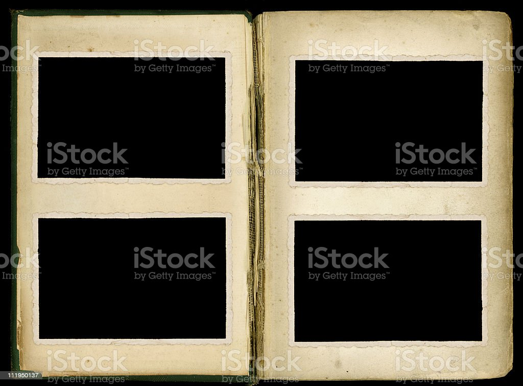 Open old book with stressed binding and four photos royalty-free stock photo