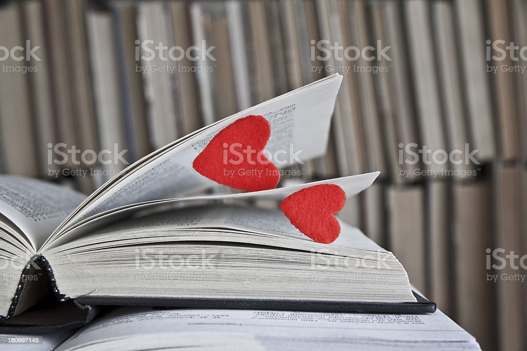 Open old vintage book and red two heart royalty-free stock photo