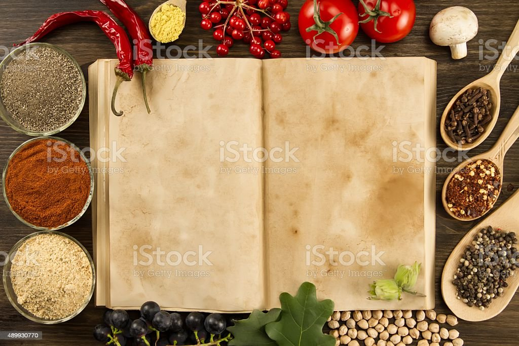open old vintage book with spices stock photo