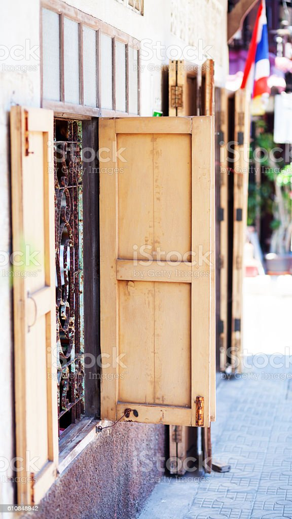 Open old wooden shutters stock photo
