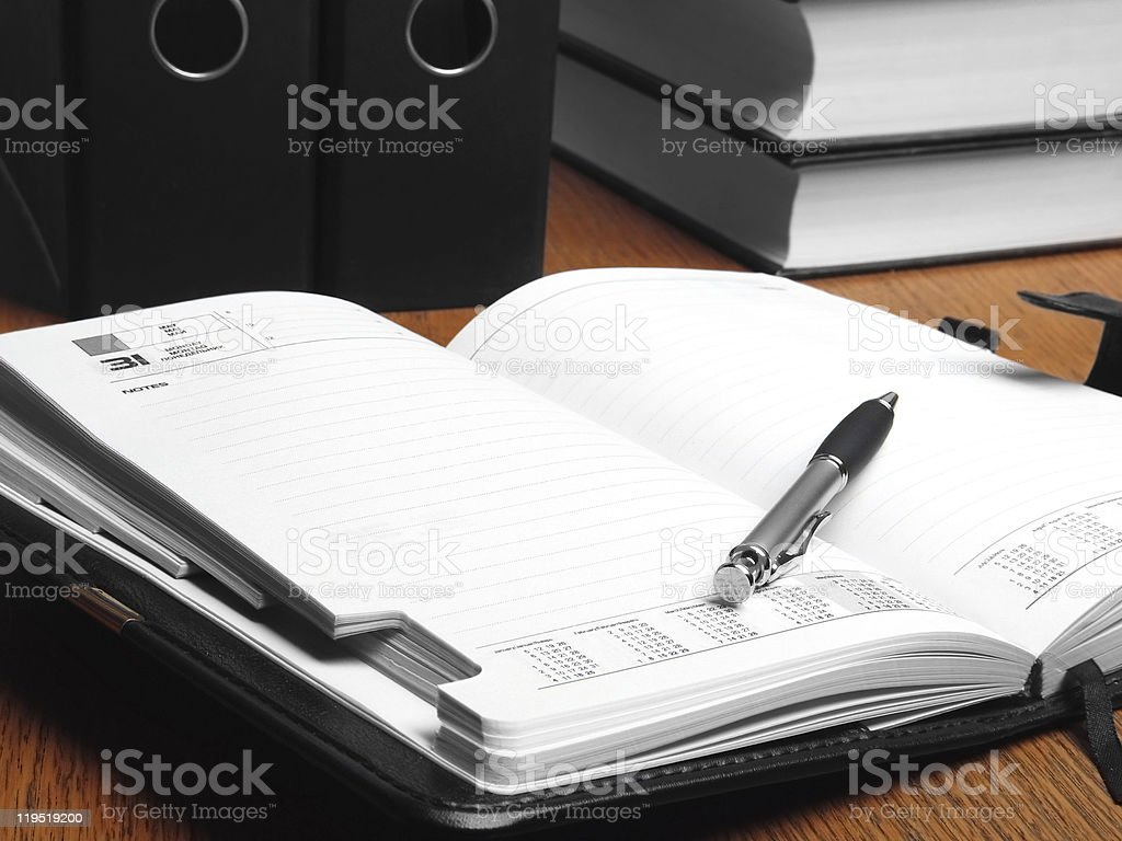 Open organizer and documents. Still life. royalty-free stock photo