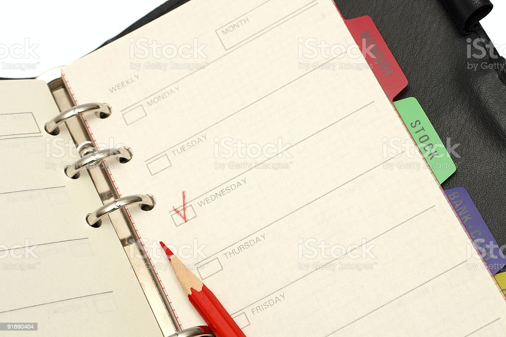 open organizer and red pencil stock photo