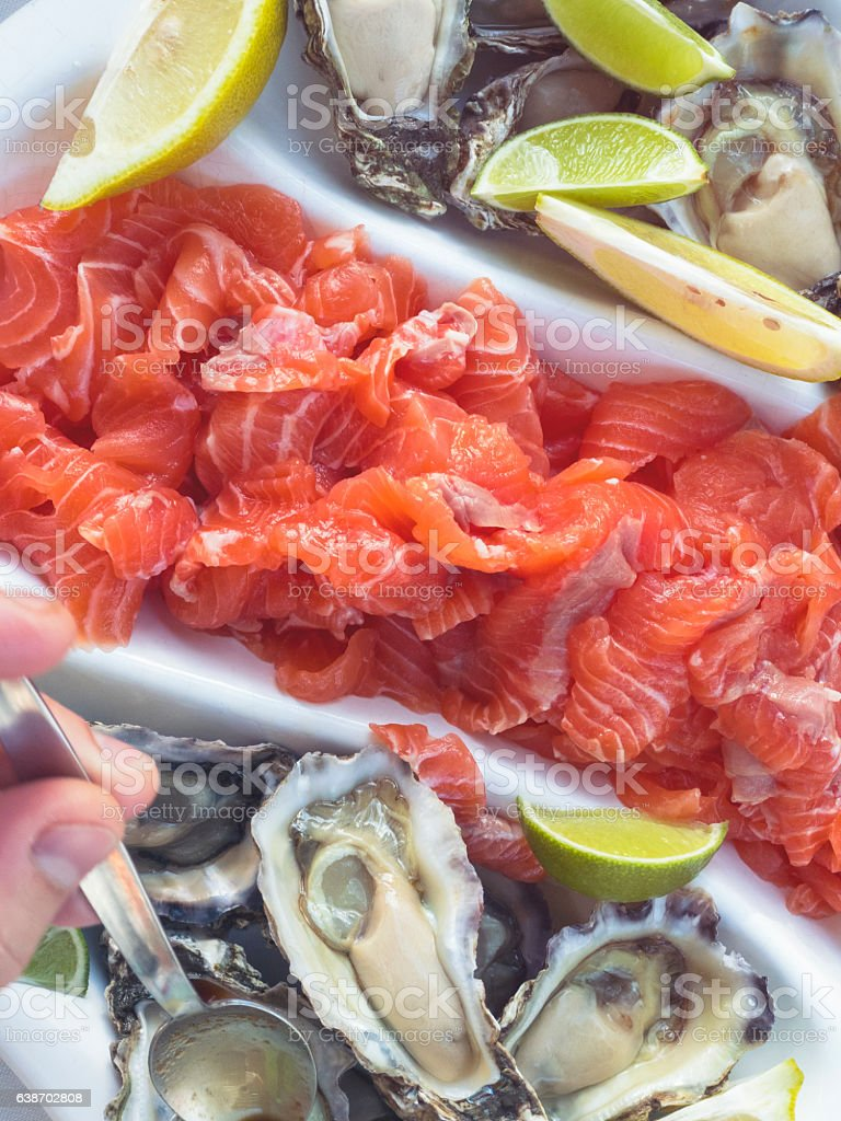 Open Oysters and salmon stock photo