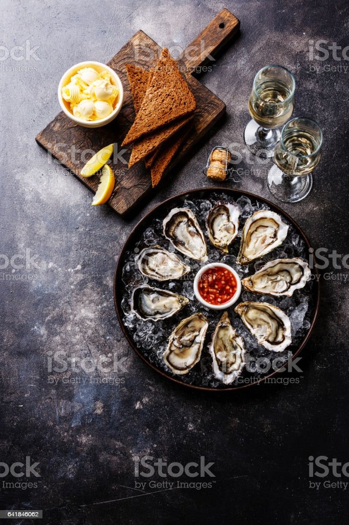 Open Oysters with bread and champagne stock photo