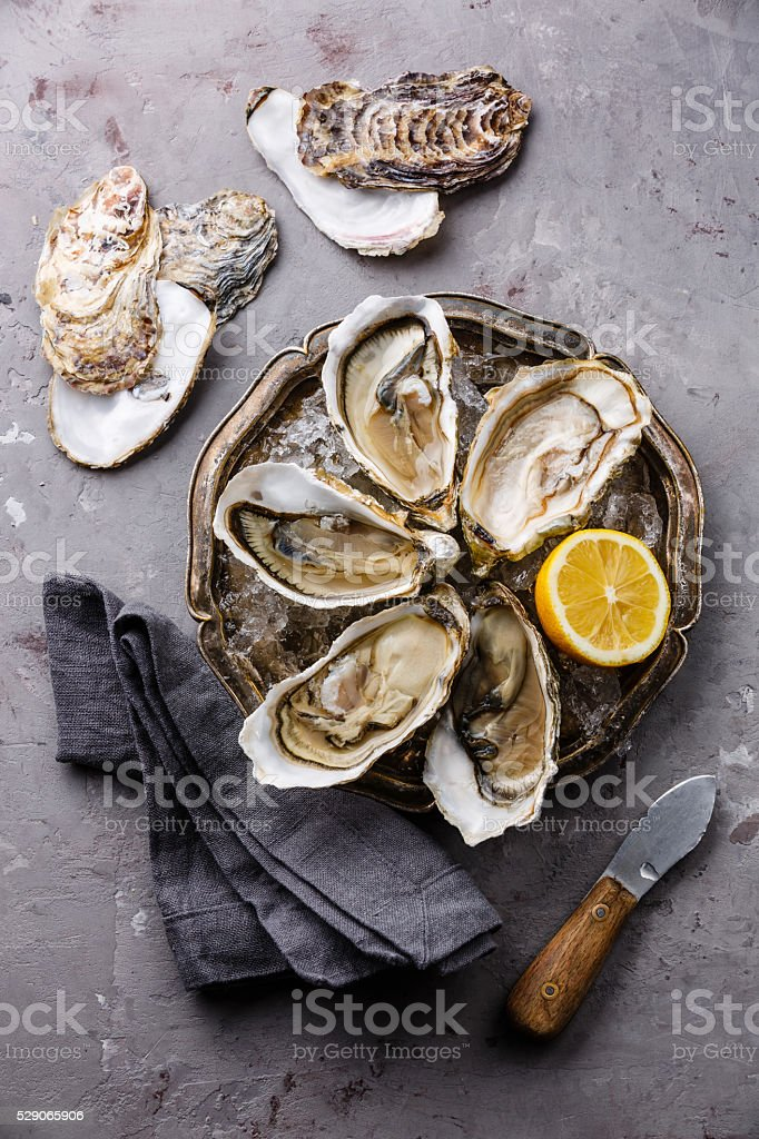 Open Oysters with ice and lemon stock photo