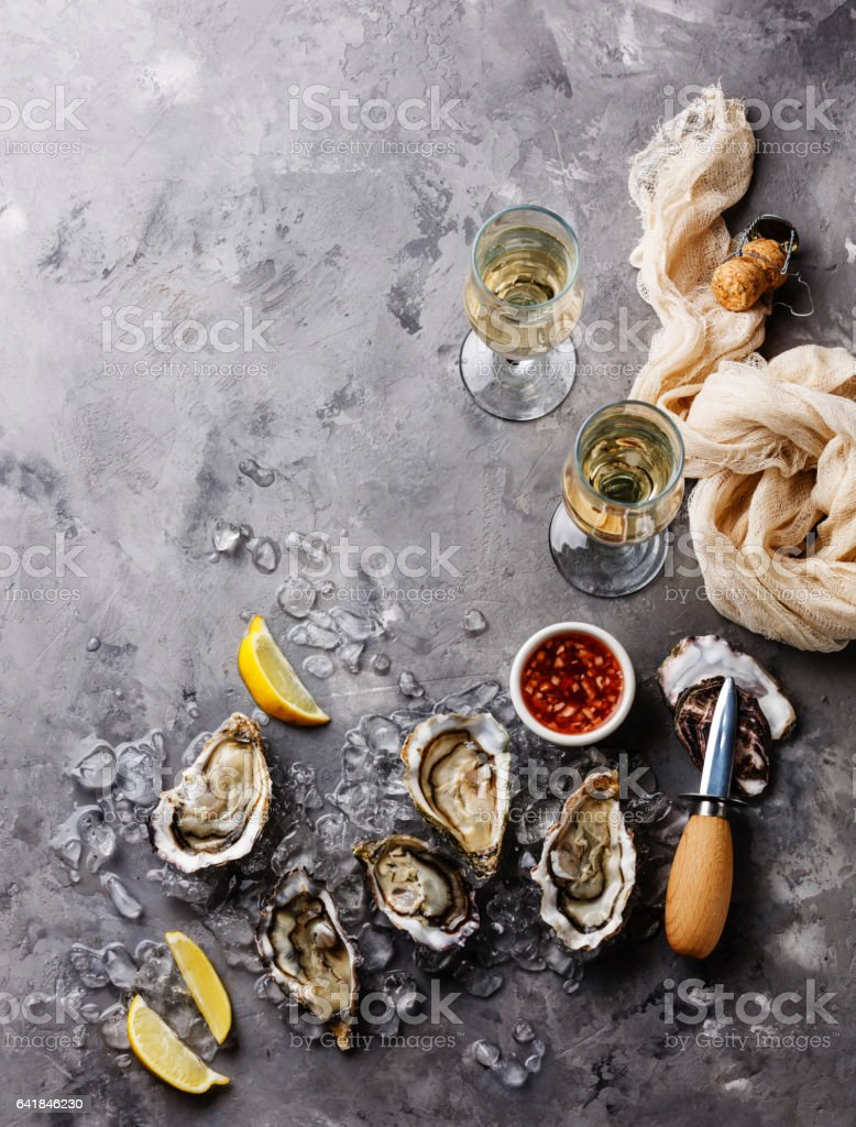 Open Oysters with sauce and champagne stock photo