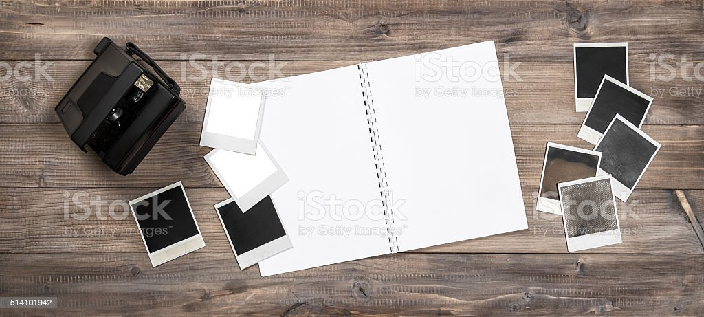 Open photo album, camera, instant print frames stock photo