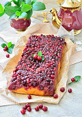 Open pie with cranberries on a table