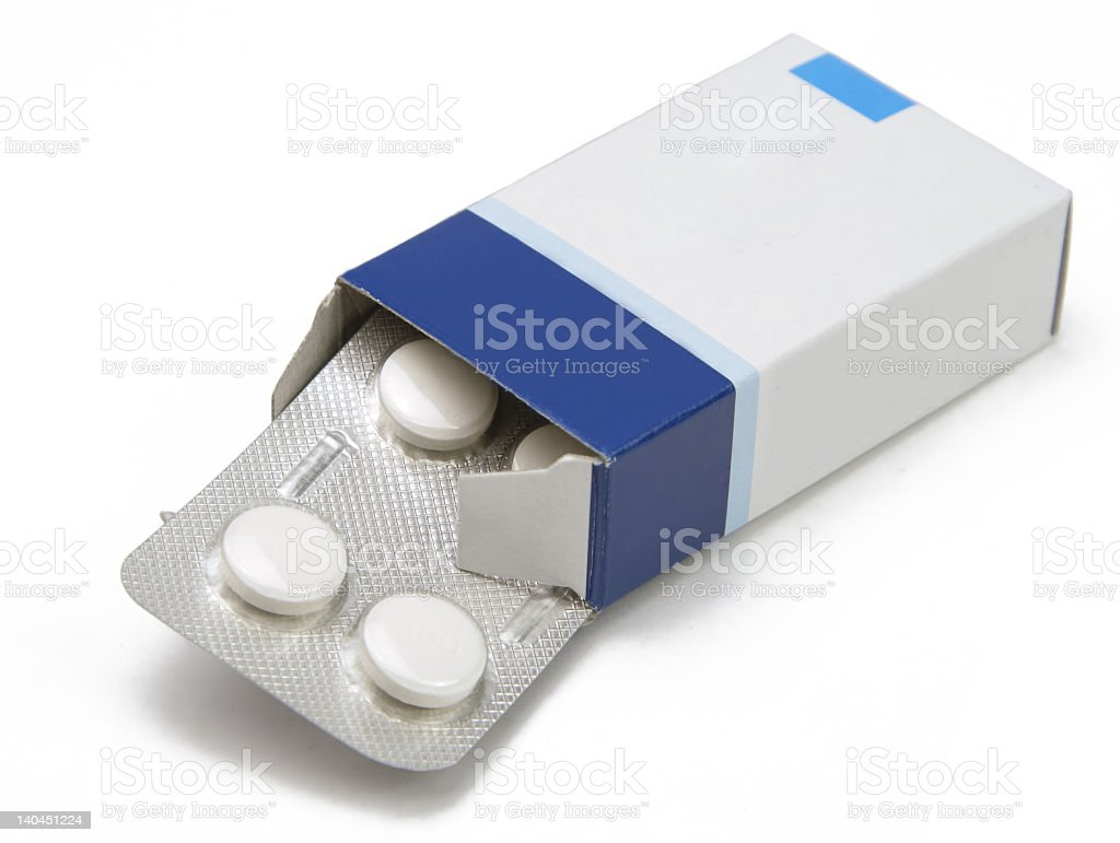 Open pill box with a blister pack of medication stock photo