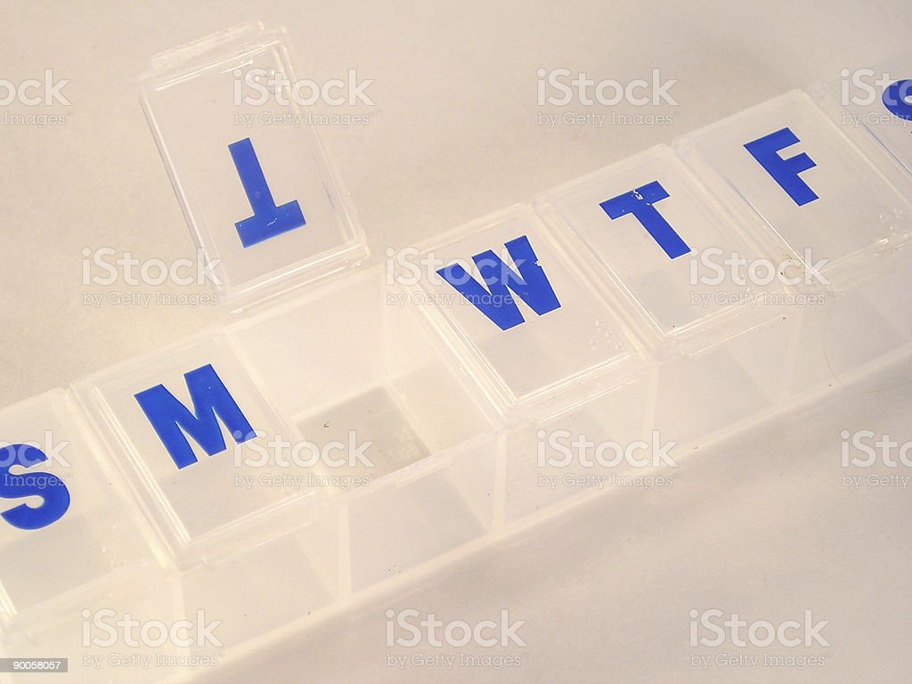 Open pill container royalty-free stock photo