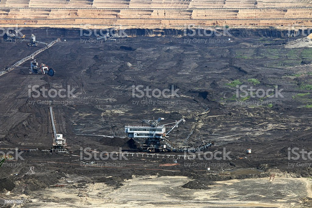 open pit coal mine with excavators and machinery stock photo
