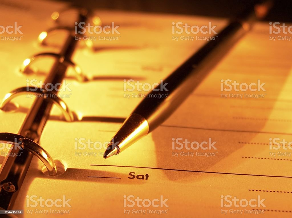 Open planner and pen royalty-free stock photo