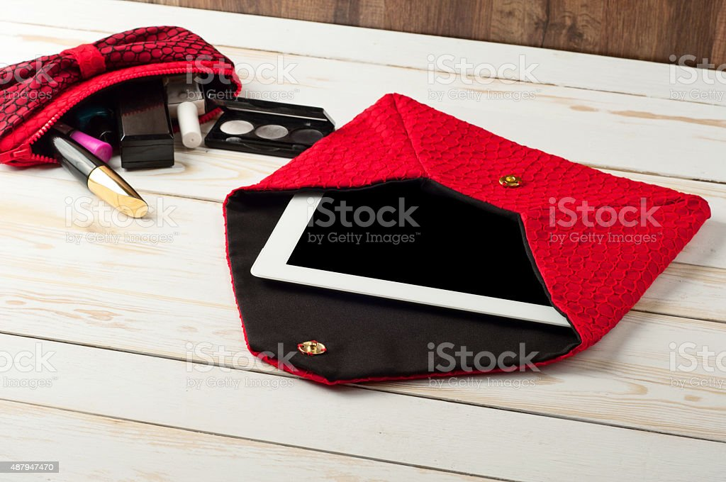 open red pen female handbag with tablet computer stock photo