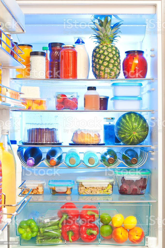 Open Refrigerator with Healthy Food Organized Inside stock photo