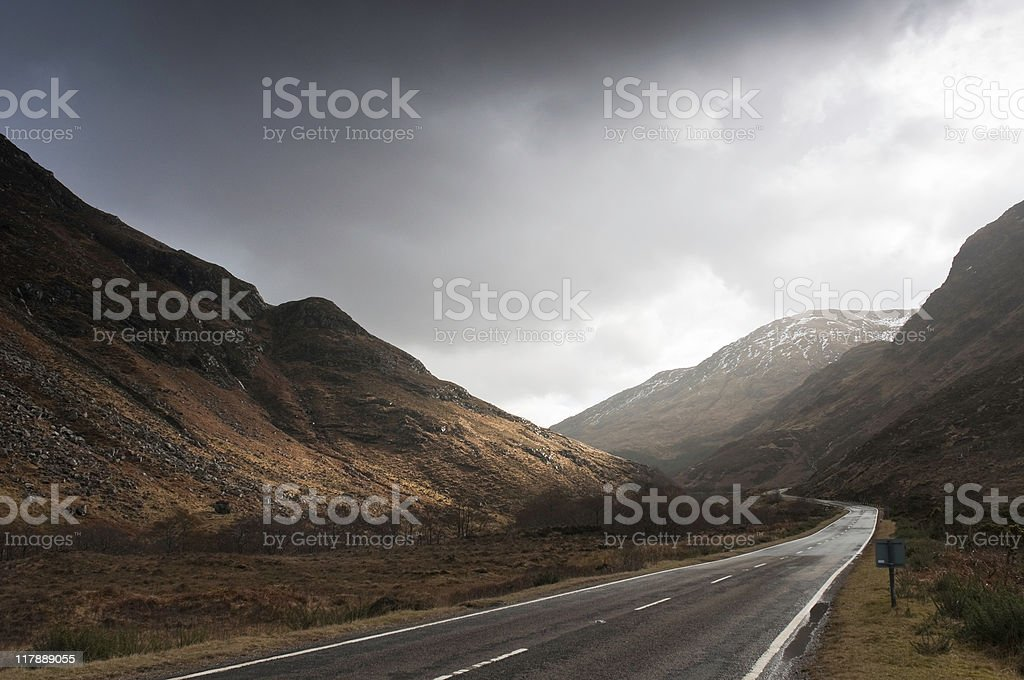 Open road and breaking storm royalty-free stock photo