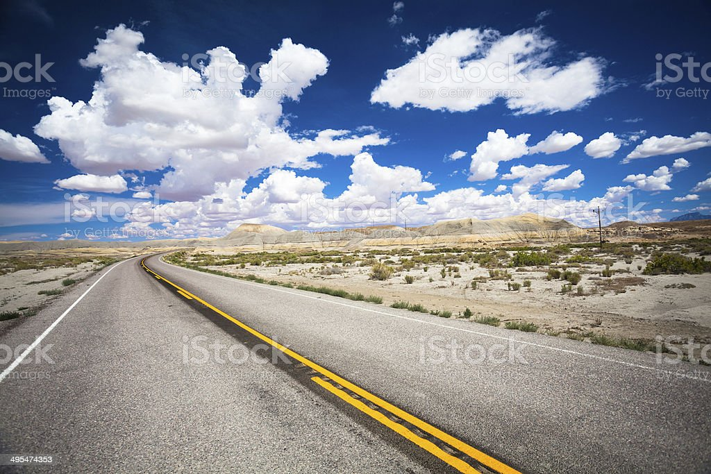 Open Road and White Clouds, USA stock photo
