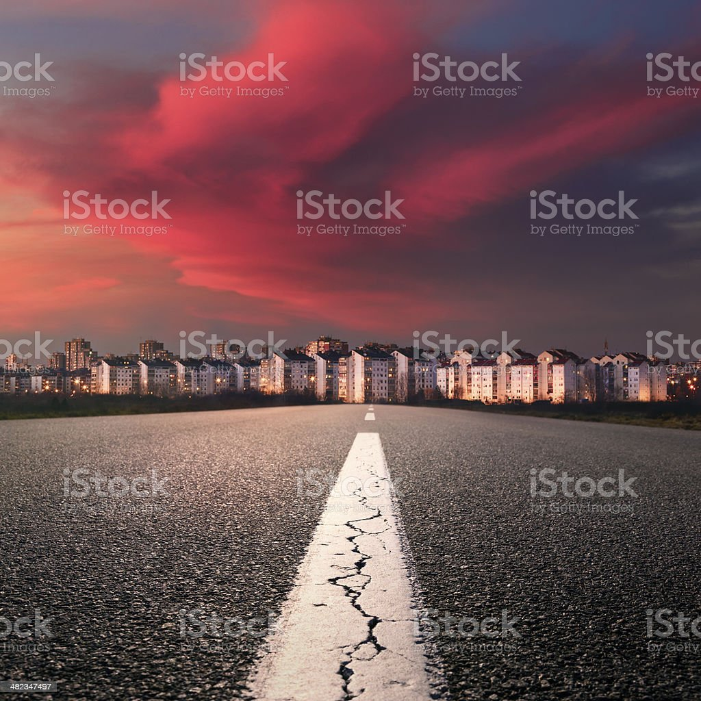 Open road. Entry into the city at sunset stock photo