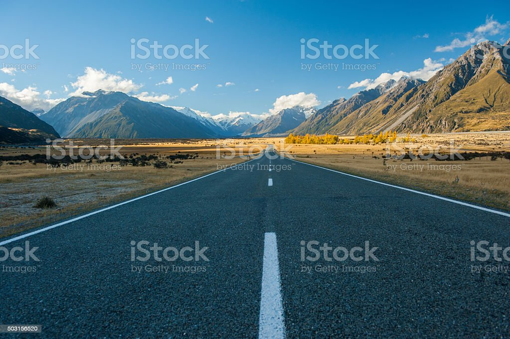 open road in the mountains, New Zealand stock photo
