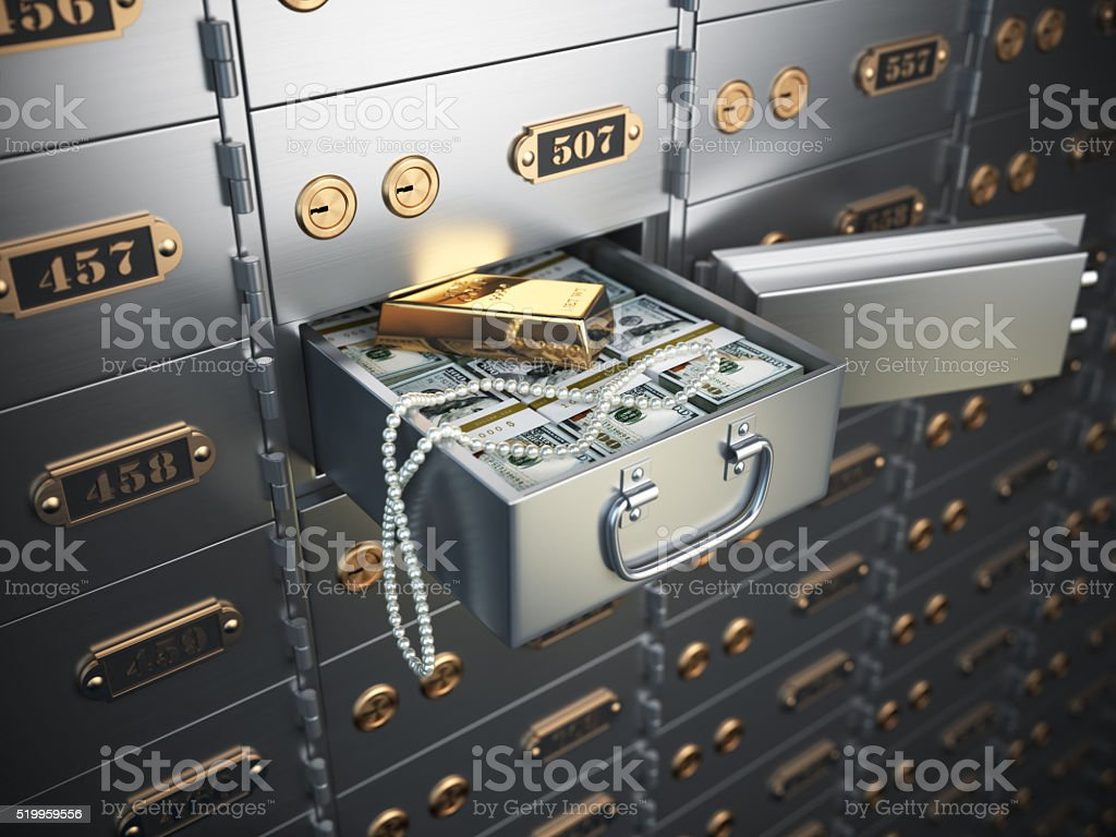 Open safe deposit box with money, jewels and golden ingot. stock photo