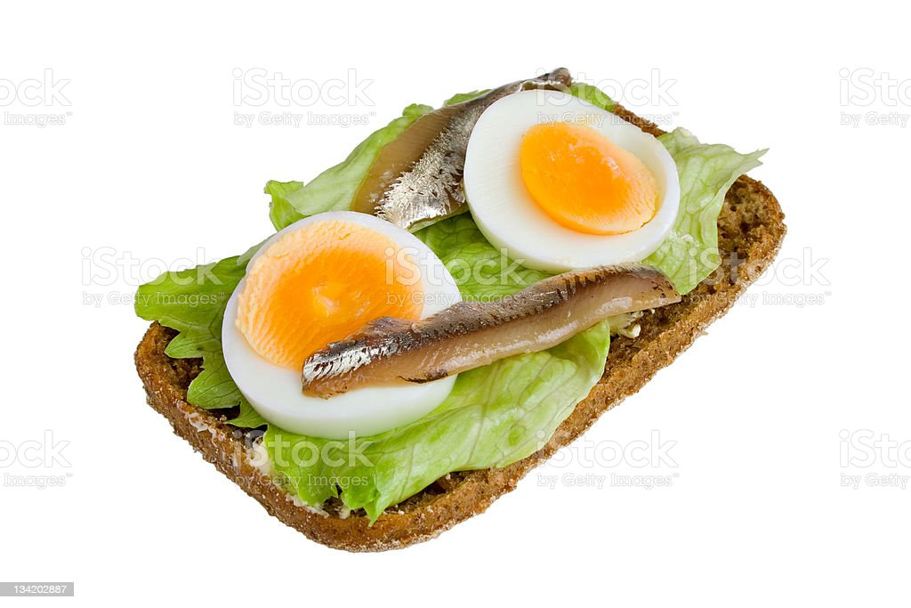 Open sandwich with egg and anchovy royalty-free stock photo