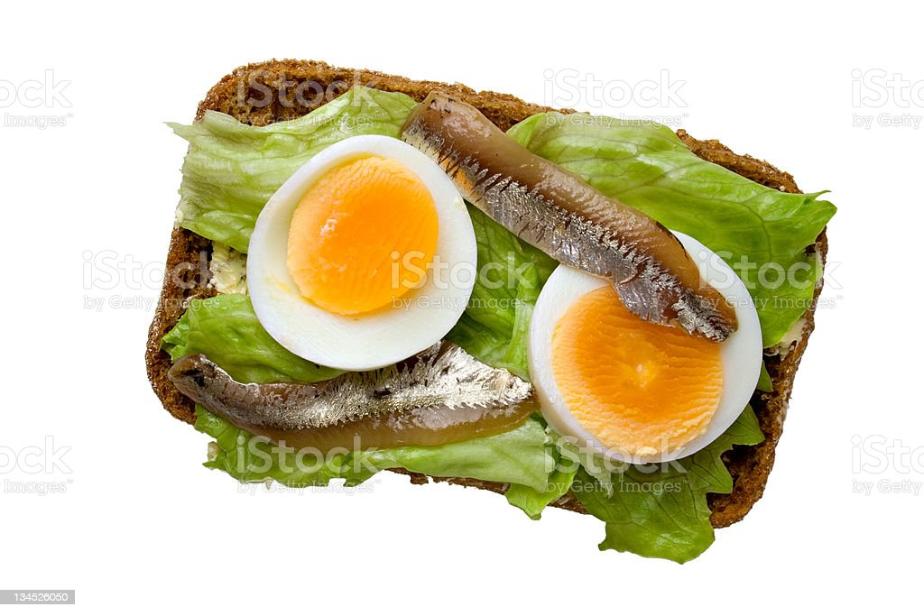 Open sandwich with egg and anchovy, upper view royalty-free stock photo