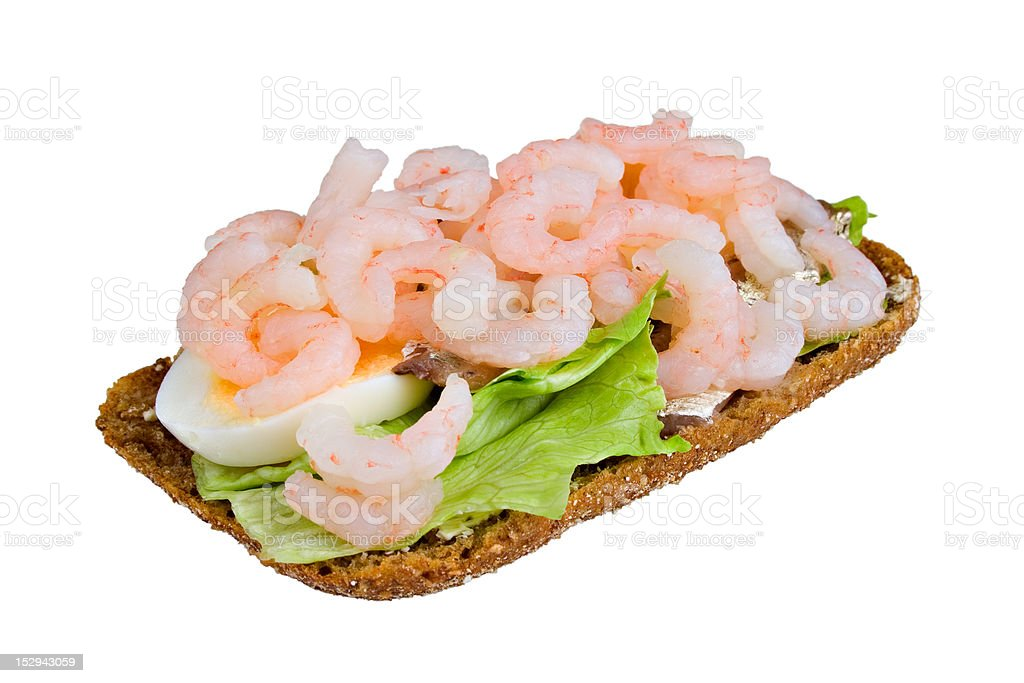 Open sandwich with shrimps, salad and anchovy royalty-free stock photo