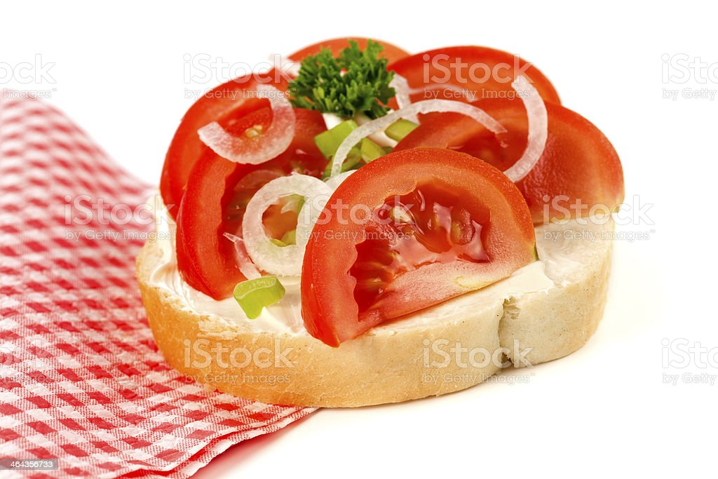 Open sandwich with tomatoes and onion royalty-free stock photo
