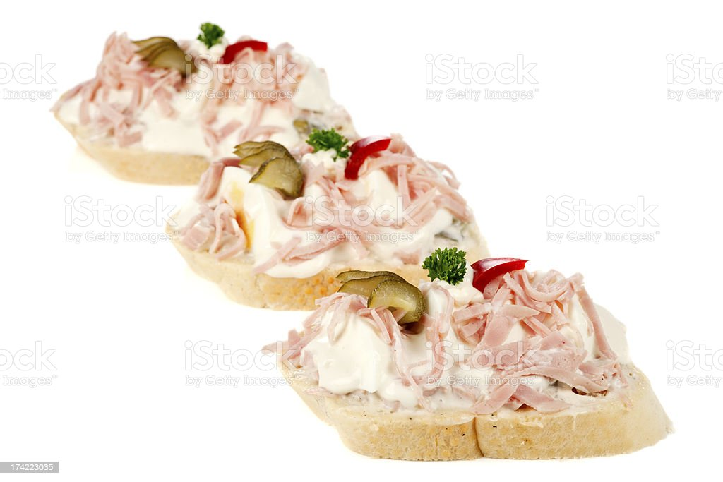 Open sandwiches with ham, eggs and potato salad royalty-free stock photo