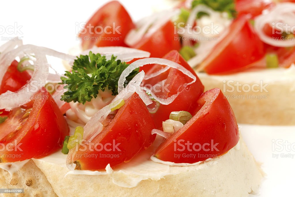 Open sandwiches with tomatoes and onion royalty-free stock photo