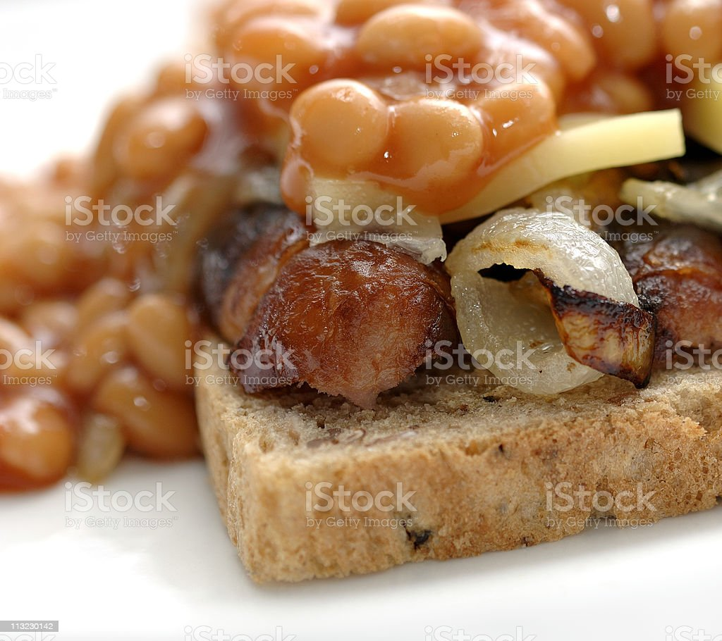 Open Sausage sandwich with onions, beans and cheese, comfort foo royalty-free stock photo