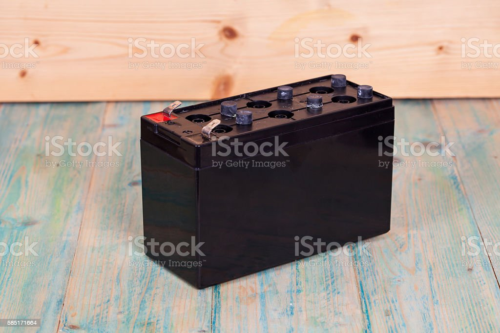 Open Sealed  battery on wwood background ,Seletive focus stock photo