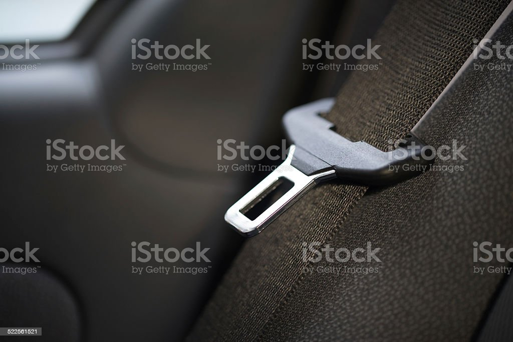 open seat belt in car on black close up stock photo