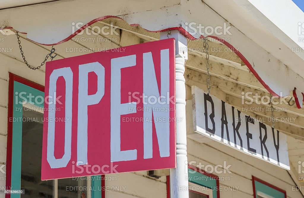 Open sign at a bakery in Coulterville, California stock photo