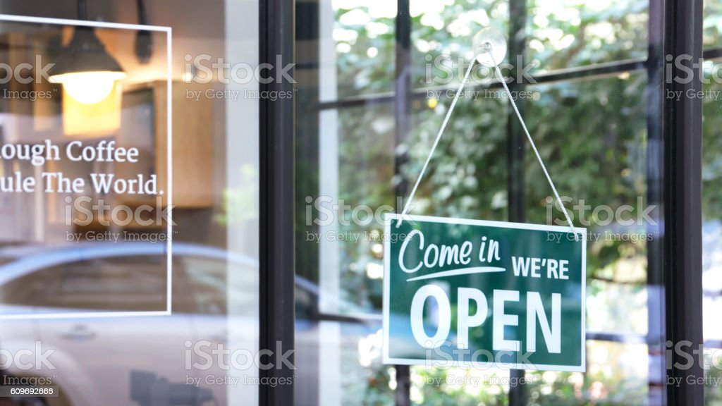 Open sign in a coffee shop stock photo