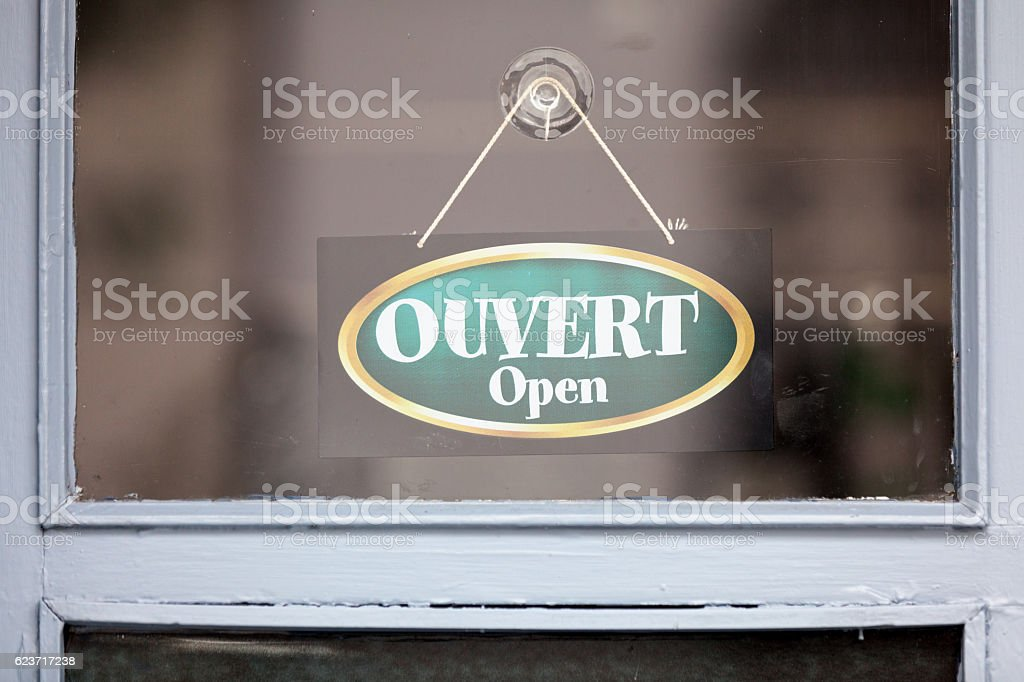 Open sign in a window stock photo