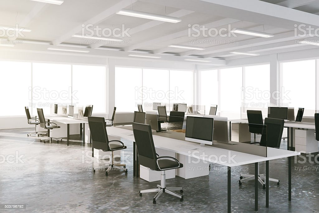 Open space loft office with furniture and big windows stock photo